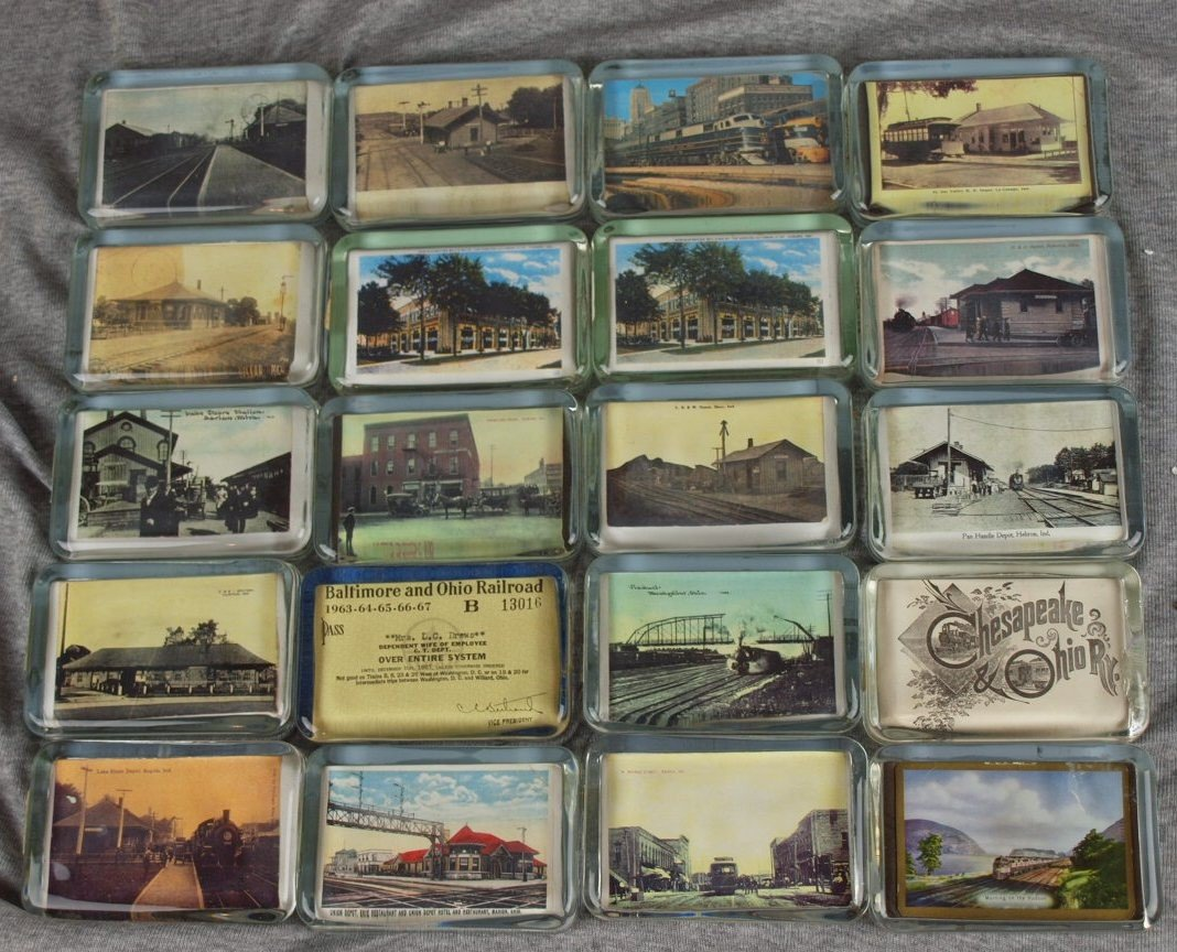 48: Lot of 20 glass paperweights with railroad related