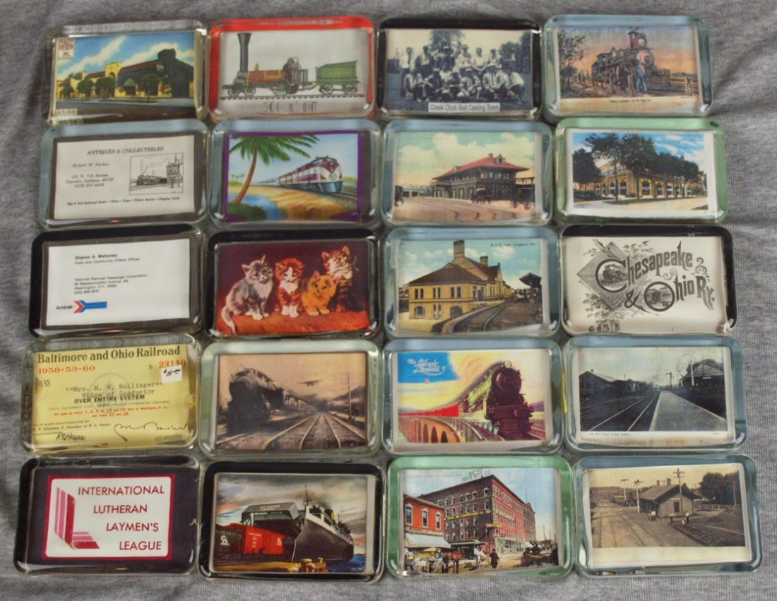 49: Lot of 20 glass paperweights with railroad related