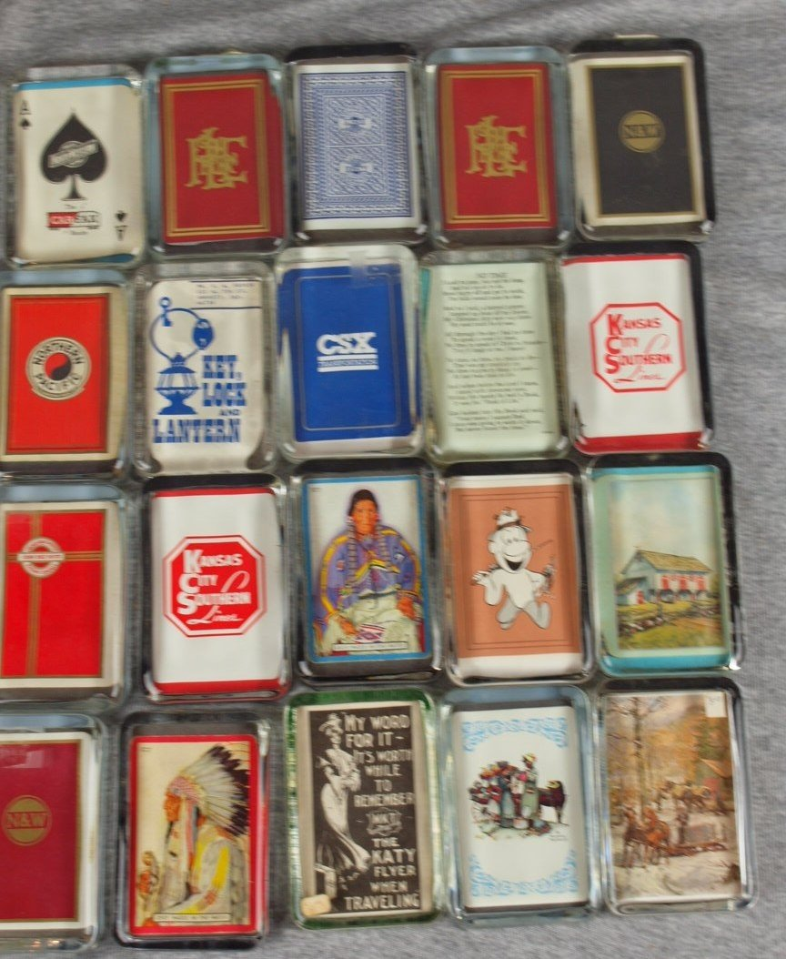 52: Lot of 20 glass paperweights with railroad related