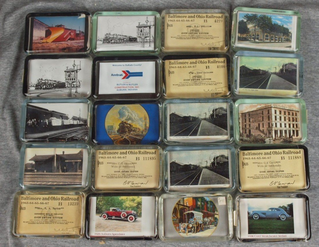 53: Lot of 20 glass paperweights with railroad related