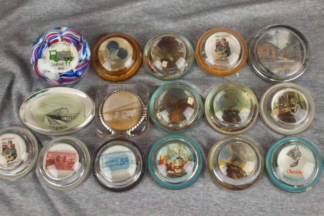 56: Lot of 16 glass paperweights most with railroad mot
