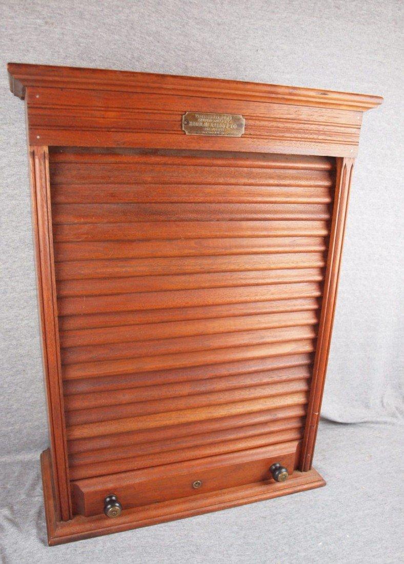 62:  Rand McNally walnut agent ticket box with roll up