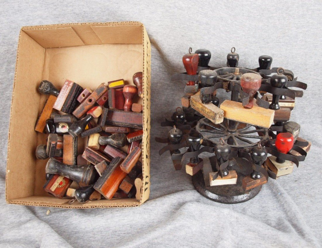 64: Two tier ink stamp stand with 57 assorted railroad