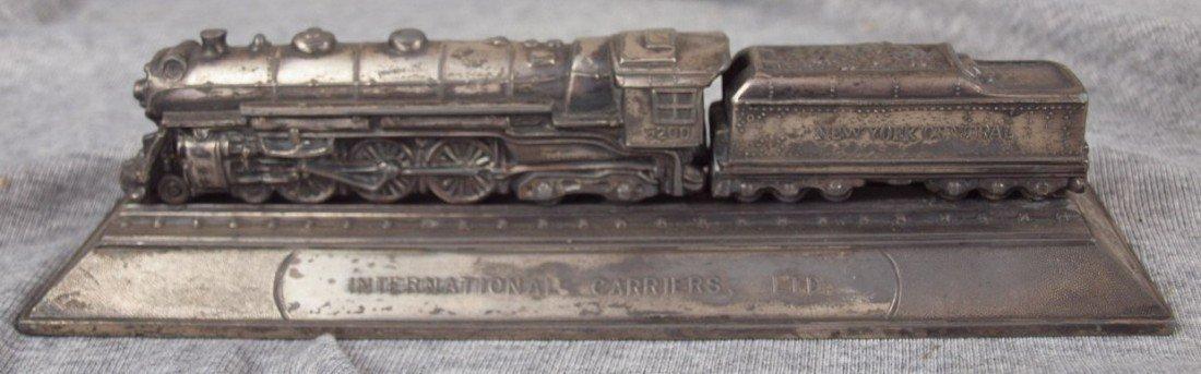 71: International Carriers Ltd. pewter desk paperweight