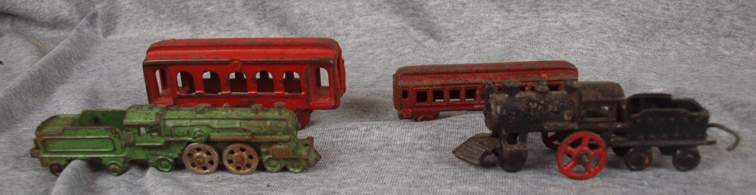 103: Lot of 4 cast iron train cars