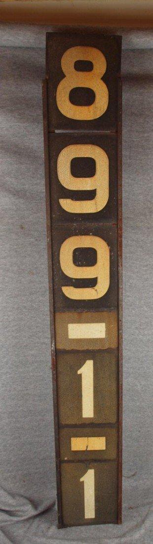"228:  Railroad sign ""899-1-1"", 7""w, 48""h"