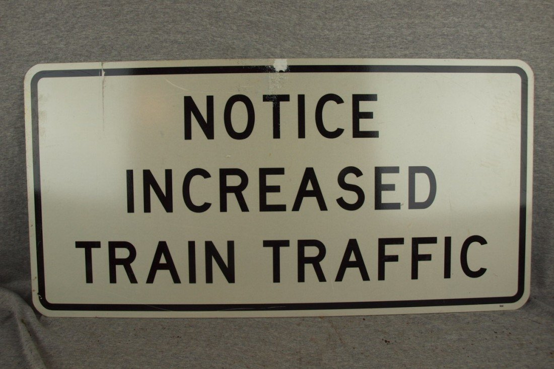 """232:  Railroad sign, single sided, """"Notice Increased Tr"""