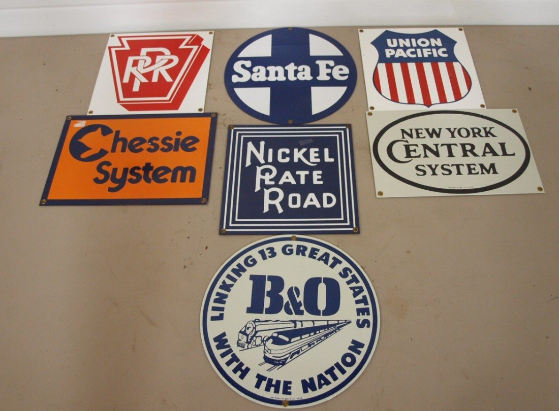 351: Lot of 7 new porcelain railroad advertising signs