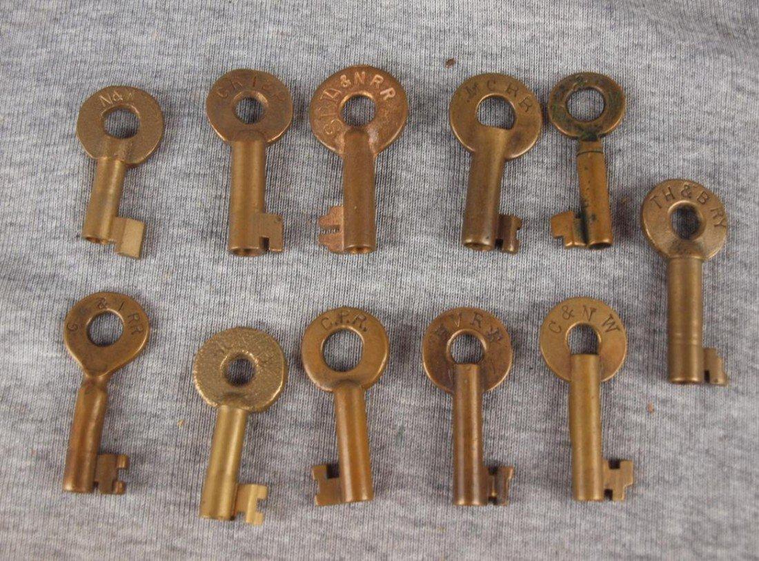 """469:  Lot of 11 brass railroad keys - """"MCRR"""", """"GR&IRR"""","""