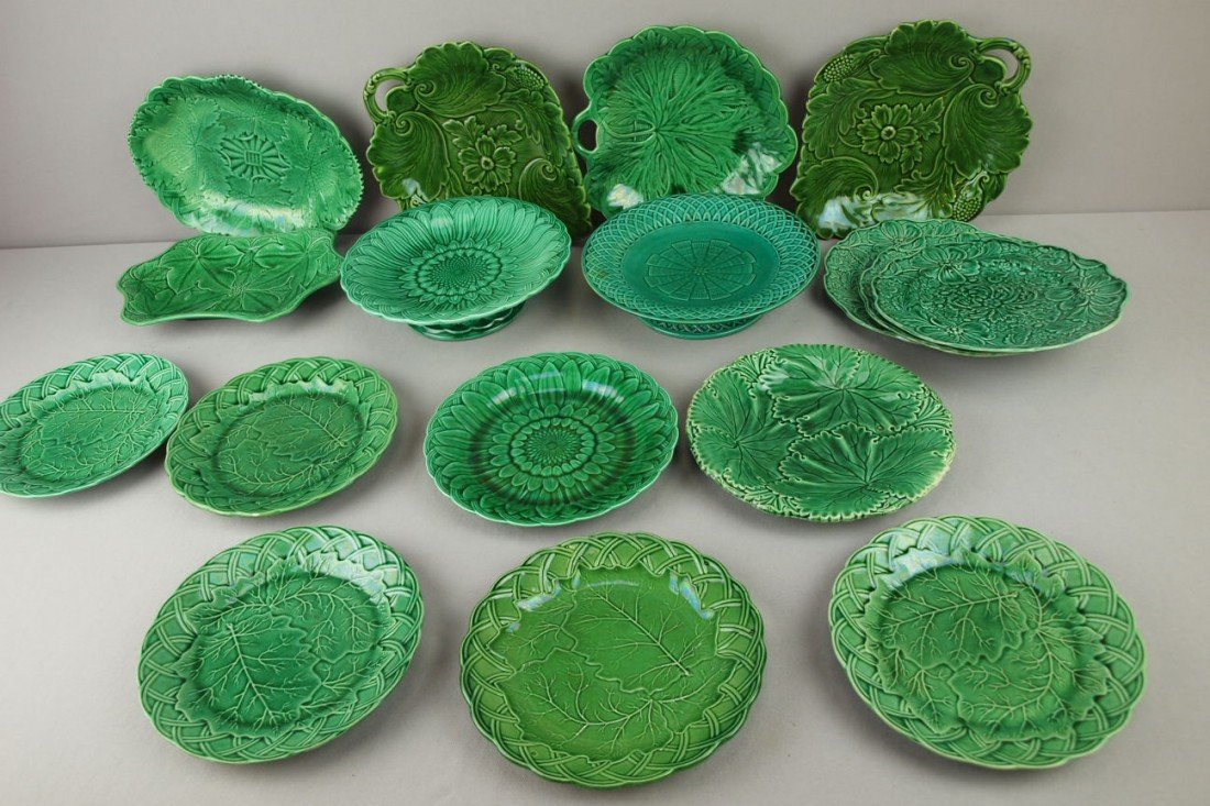 29: Majolica lot of 17 dark green plates, trays and com