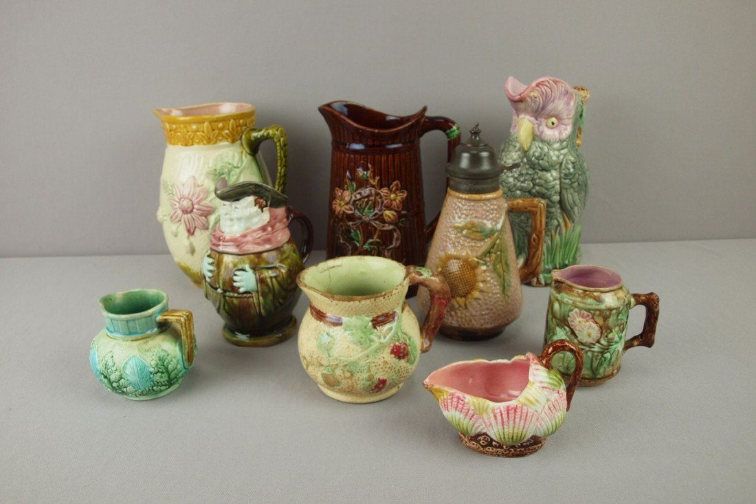 30: Majolica lot of 9 pitchers, various condition