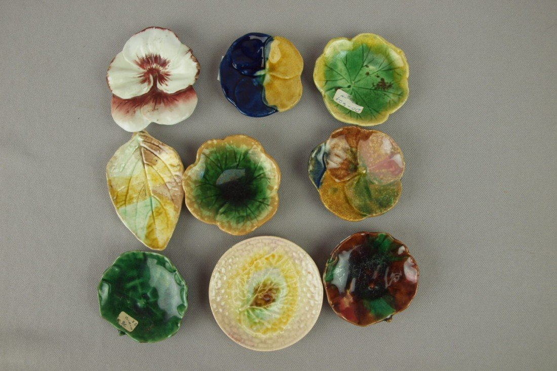 32: Majolica lot of 9 butter pats, various condition