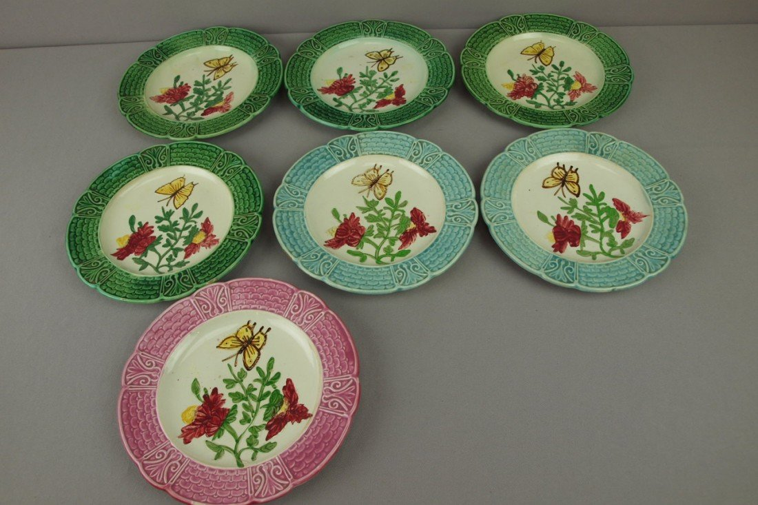 "39: Lot of 7-8 1/2"" French majolica plates with flowers"