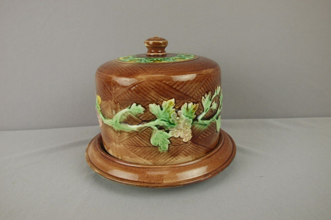 41: Majolica rustic floral cheese keeper, rim repair to