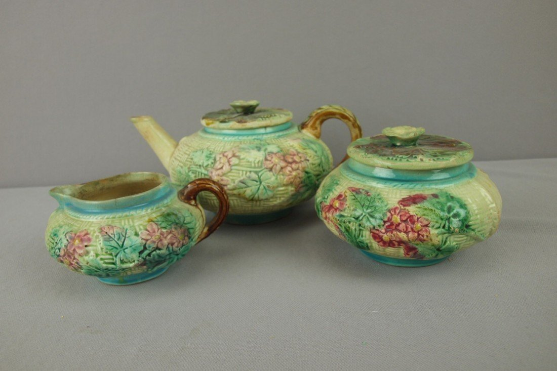48: Majolica basketweave and floral 3 piece teaset, var