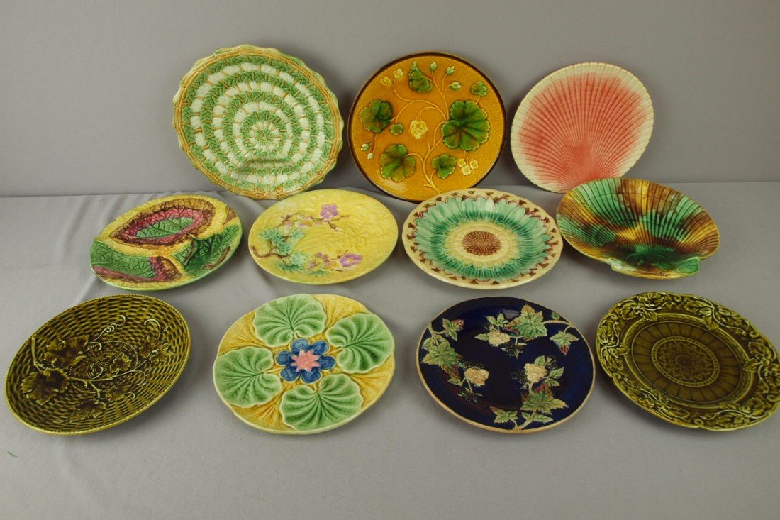 169: Majolica lot of 11 plates, various condition
