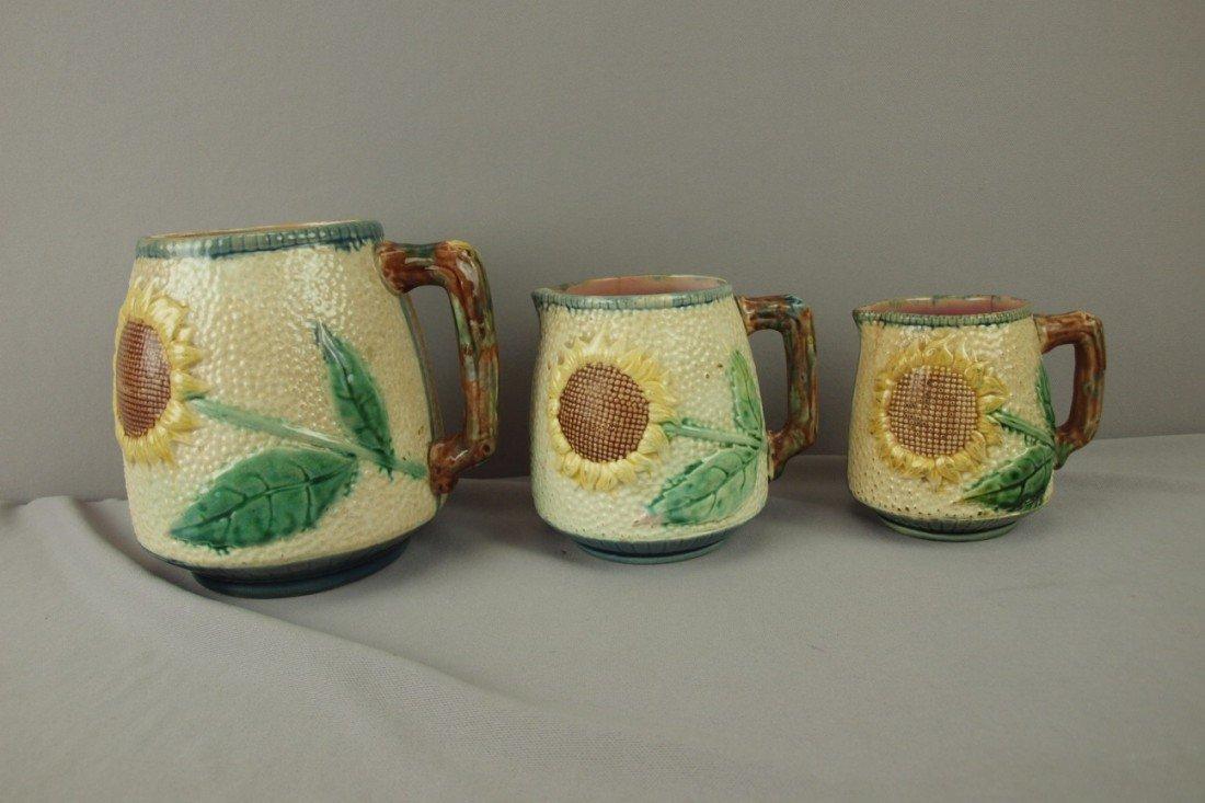 171: ETRUSCAN set of 3 graduated sunflower pitchers, va