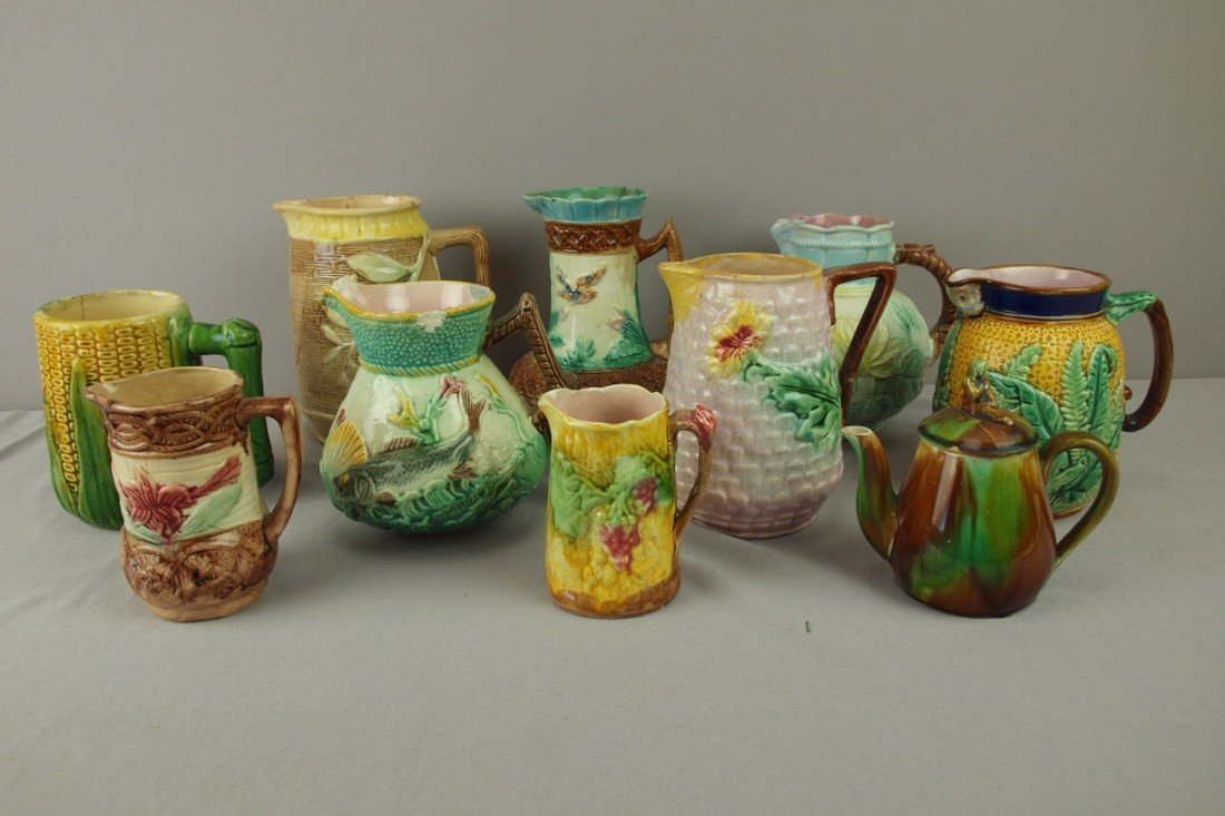 182: Majolica lot of 10 pitchers, various condition