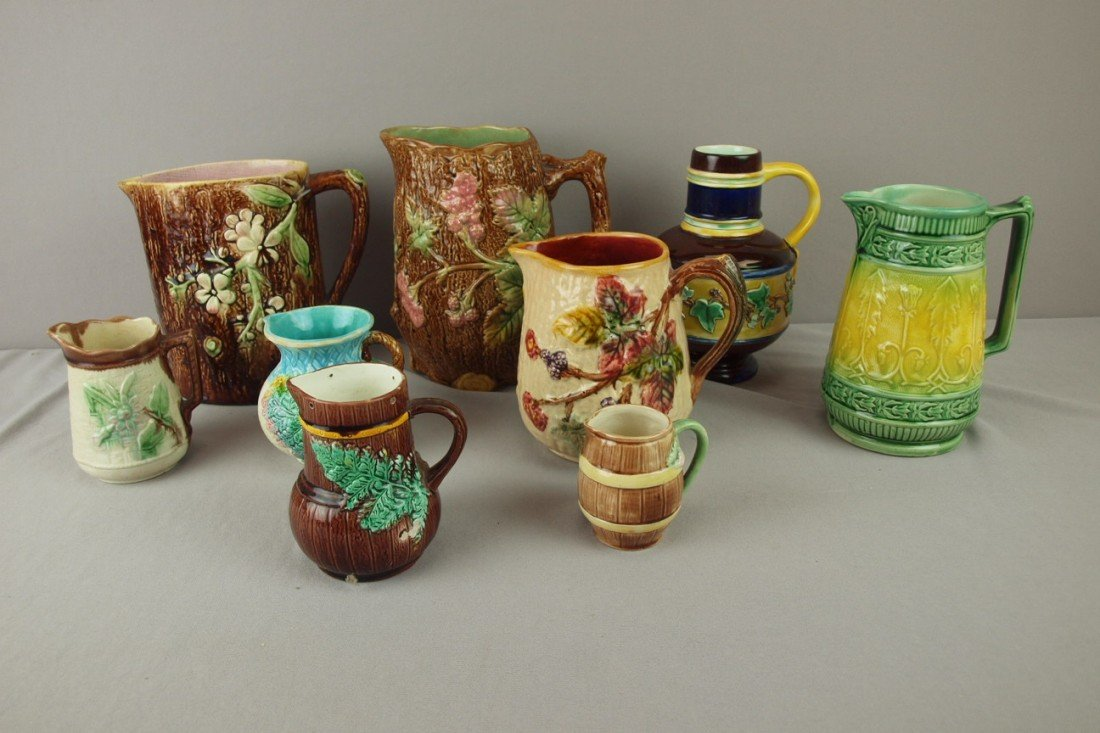 185: Majolica lot of 9 pitchers and creamers, various c