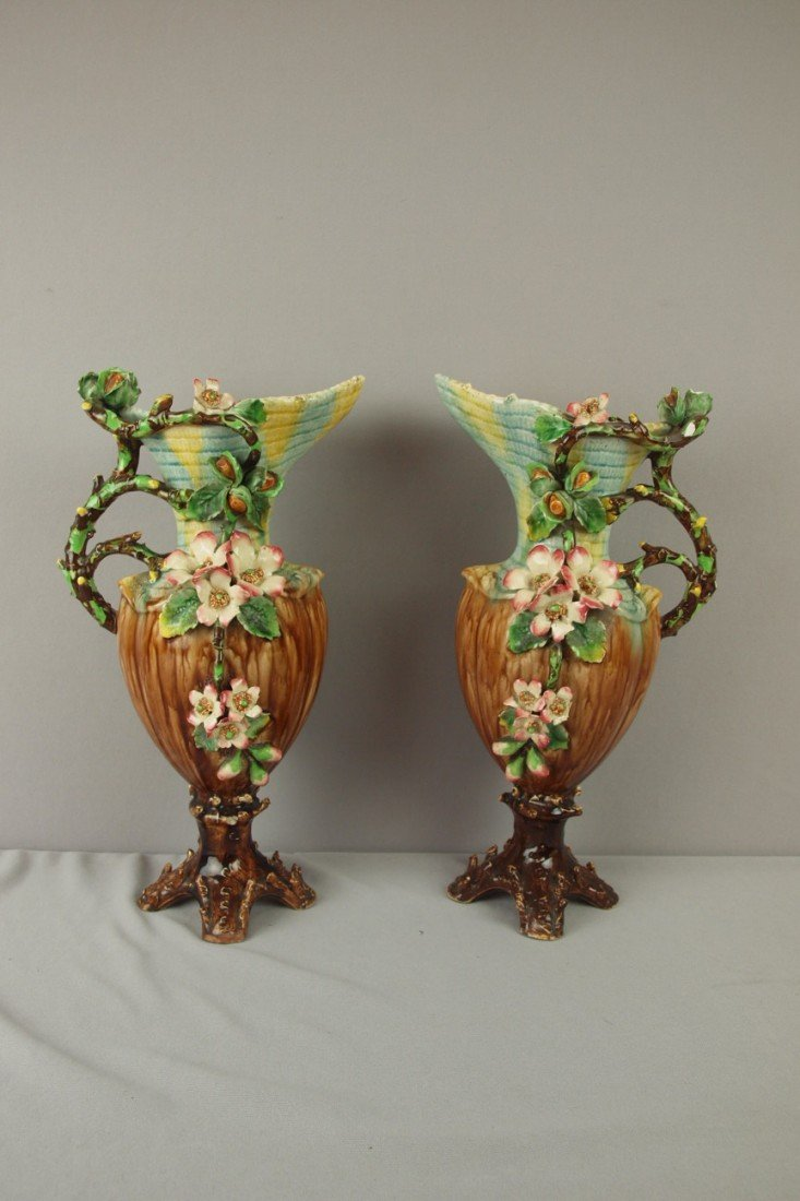 187: Pair of French Barbotine majolica ewers with appli