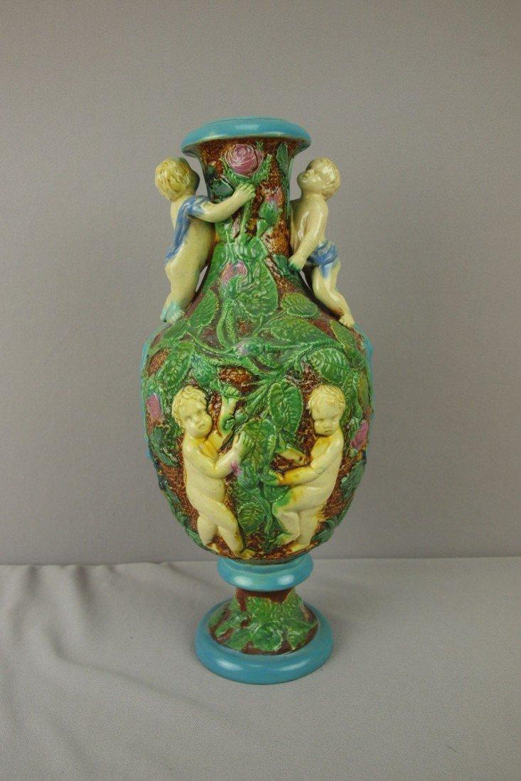 188: BROWNFIELD wild rose vase with puttis, restoration
