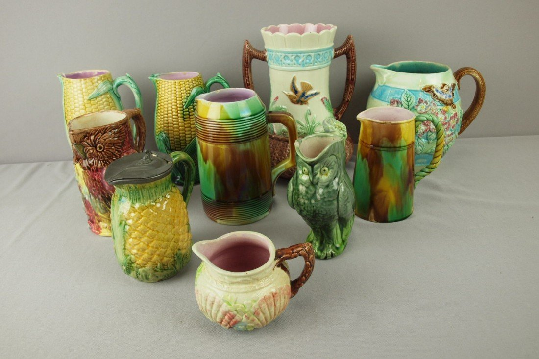 225: Majolica lot of 10 pieces - 9 pitchers/creamers an