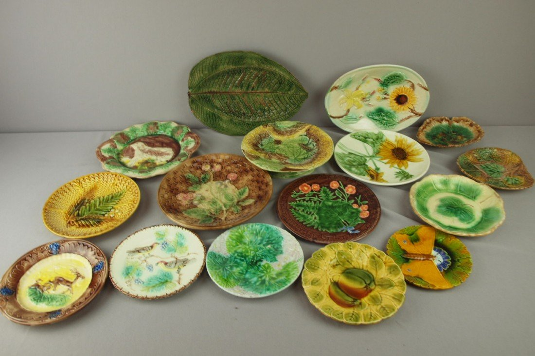 235: Majolica lot of 16 plates, platters, compote and t