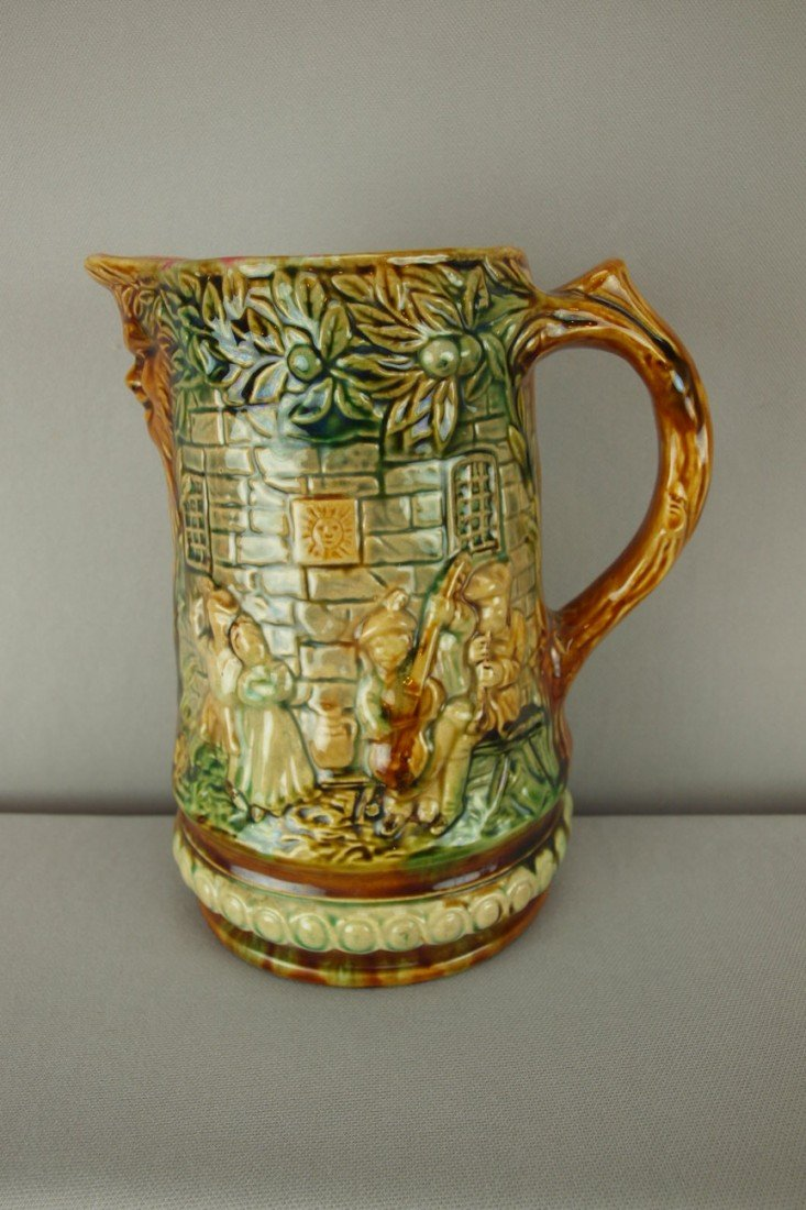 302: Onnaing French majolica pitcher with figures in re