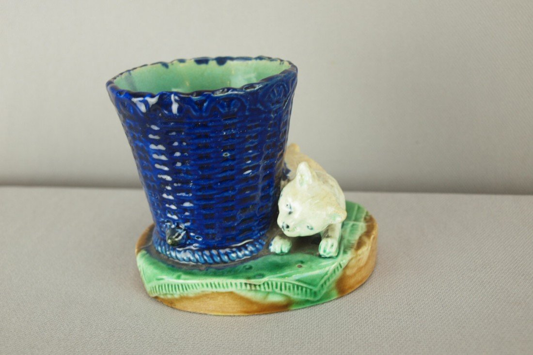 508: Majolica figural match pot with cat and basket, pr