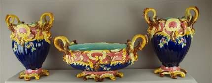 611: French majolica three piece garniture set with cob