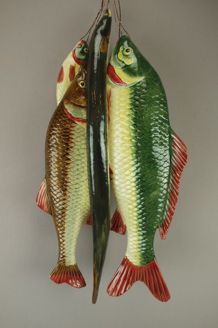 651: Majolica figural wall plaque with three fish and a
