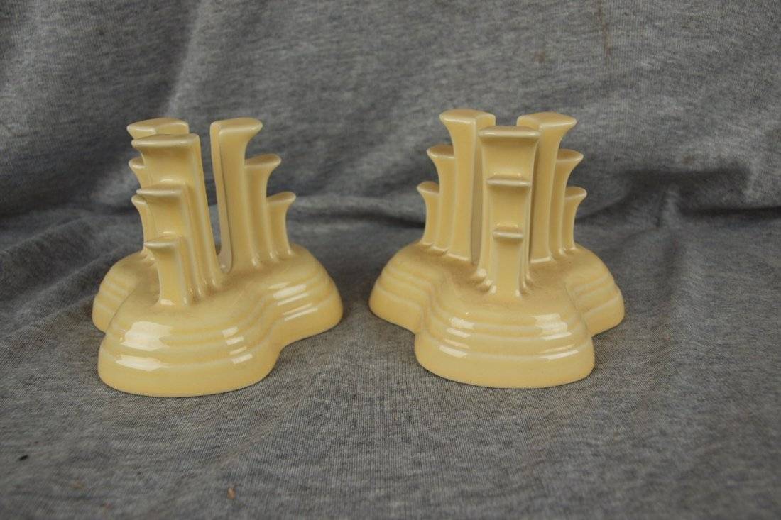 75: Fiesta Post 86 Ivory pyramid pair of candle holders