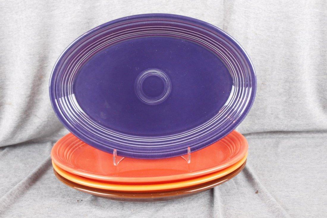 84: Fiesta Post 86 platter group - Plum, Persimmon, Tan