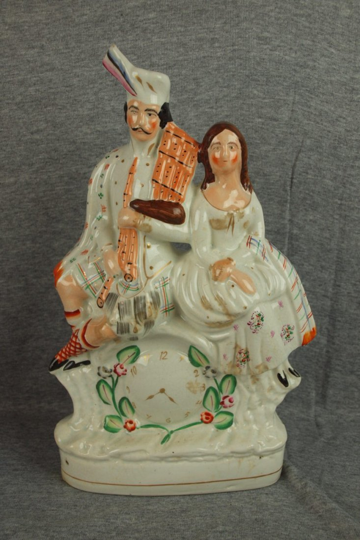 160: Staffordshire clock statue with man and woman, 13