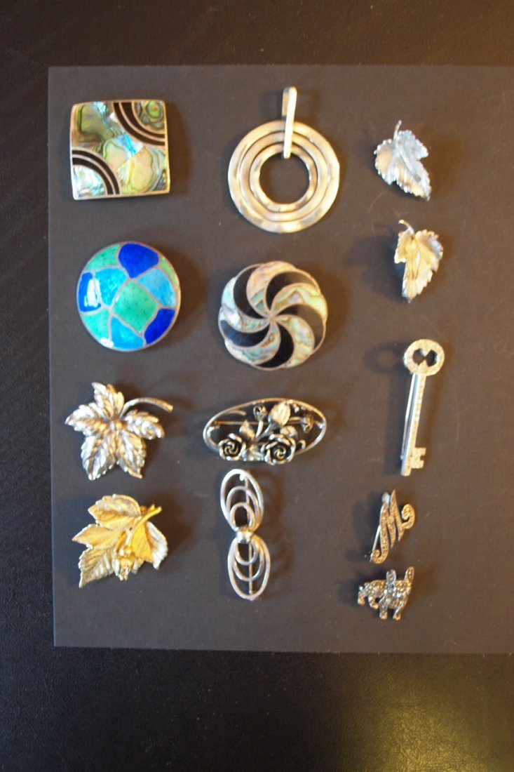 109: Lot of 13 sterling pins