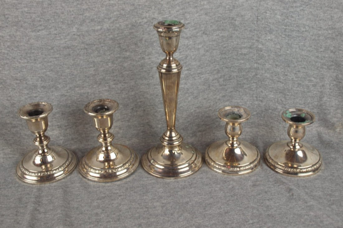 610: Lot of 5 sterling silver candle holders