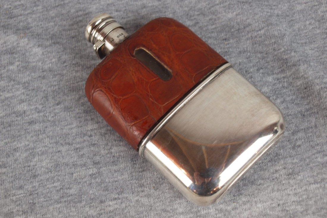 615:  Flask with aligator leather sleave, silver top an