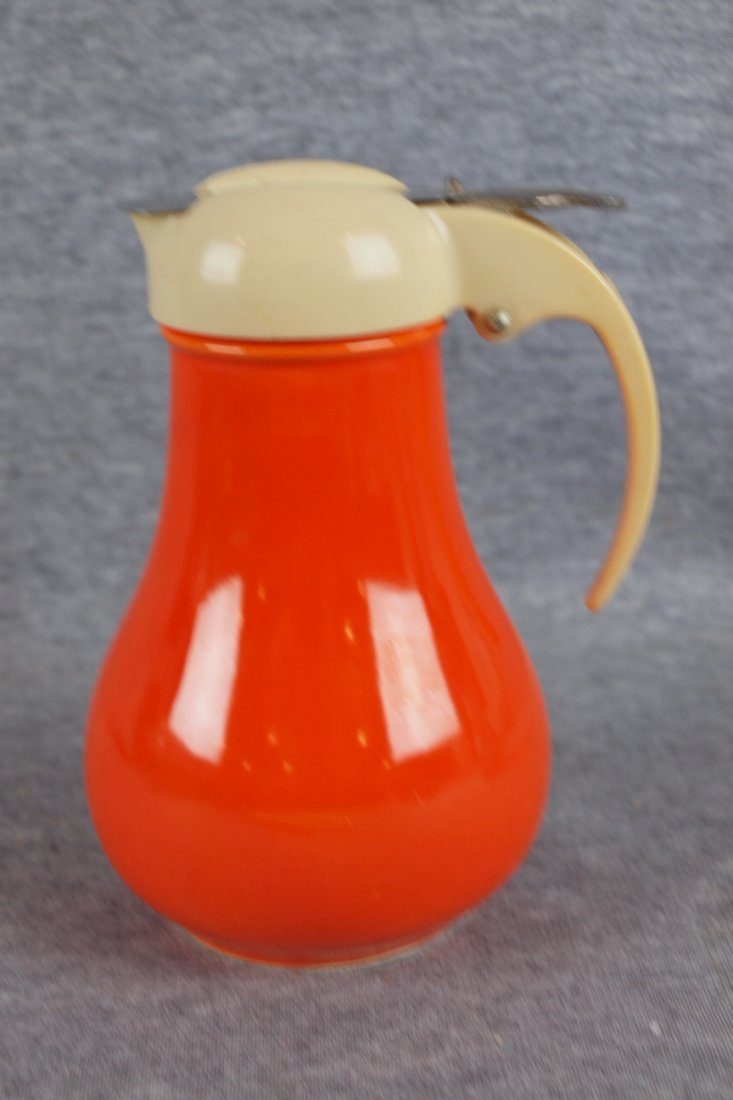 215:  Fiesta syrup pitcher, red with ivory top
