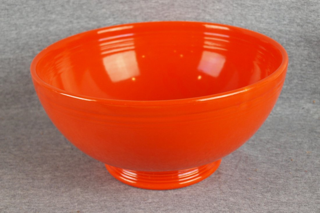 217:  Fiesta footed salad bowl, red, minor rim nick