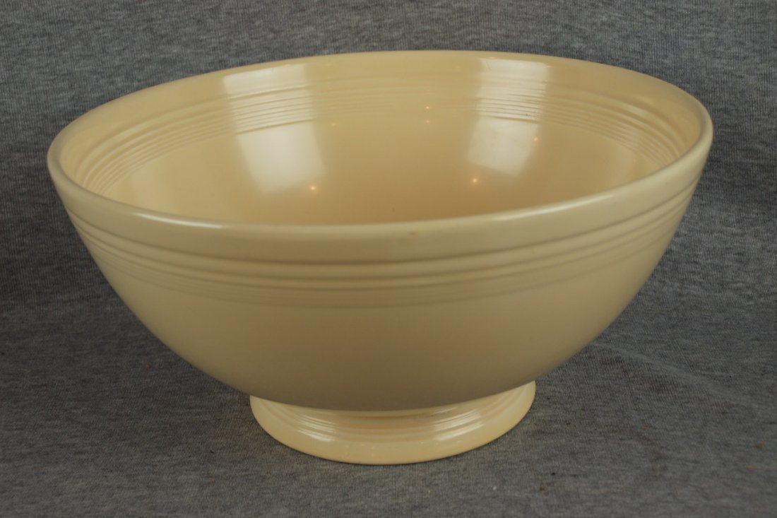 218:  Fiesta footed salad bowl, ivory, glaze flaw insid