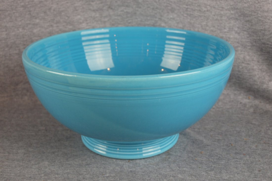 223:  Fiesta footed salad bowl, turquoise, base chip