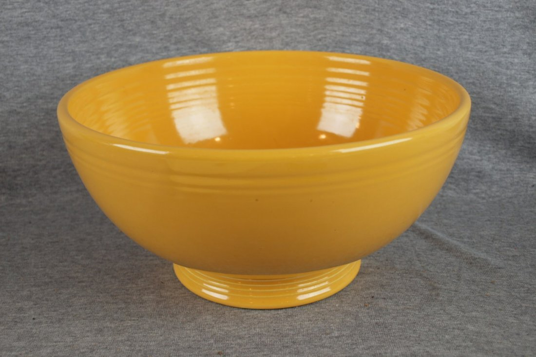 224:  Fiesta footed salad bowl, yellow, glaze bubble in