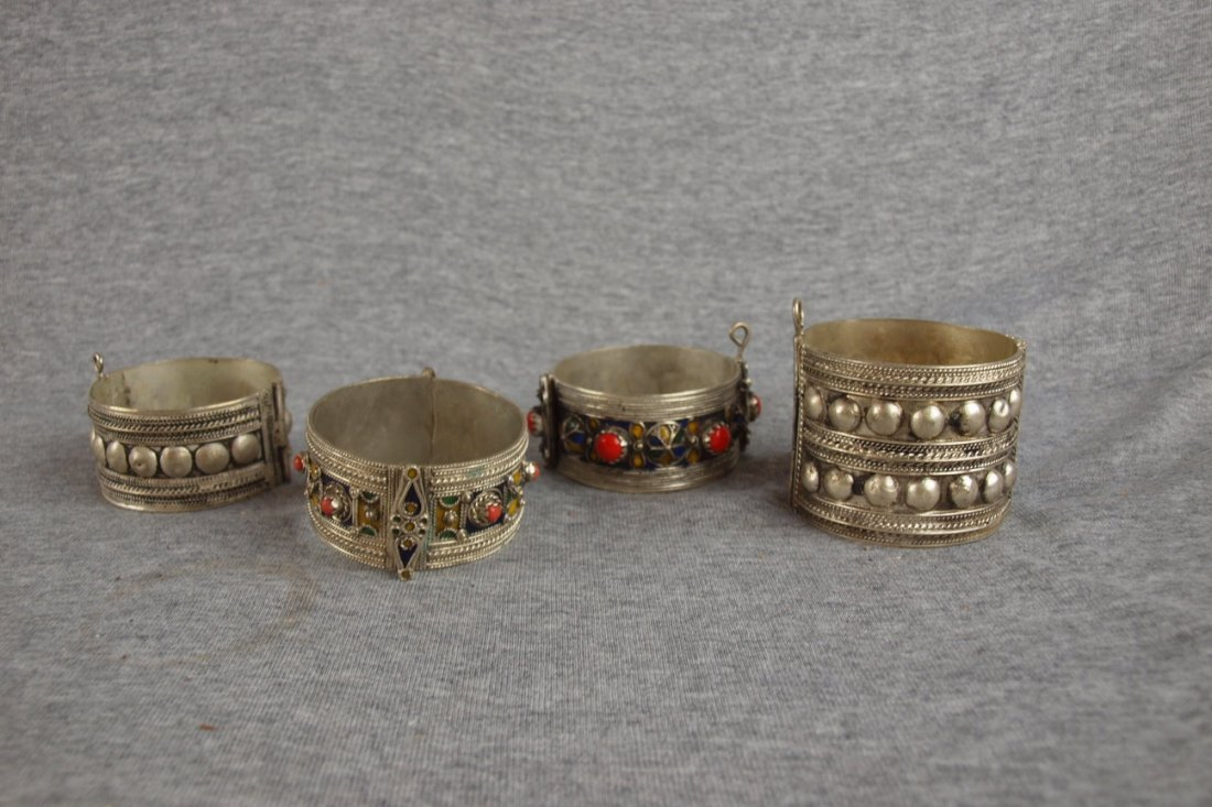 21:  Lot of 4 silver bracelets, 2 with silver stone set