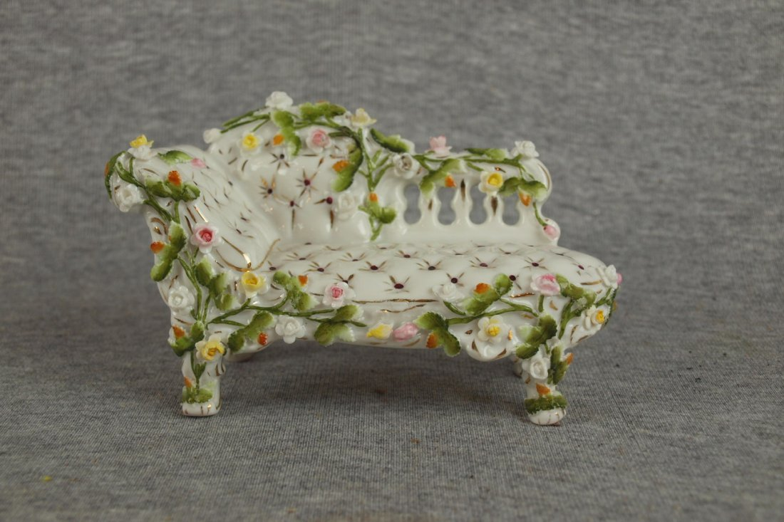 519:  Meissen porcelain figure of fainting couch with f