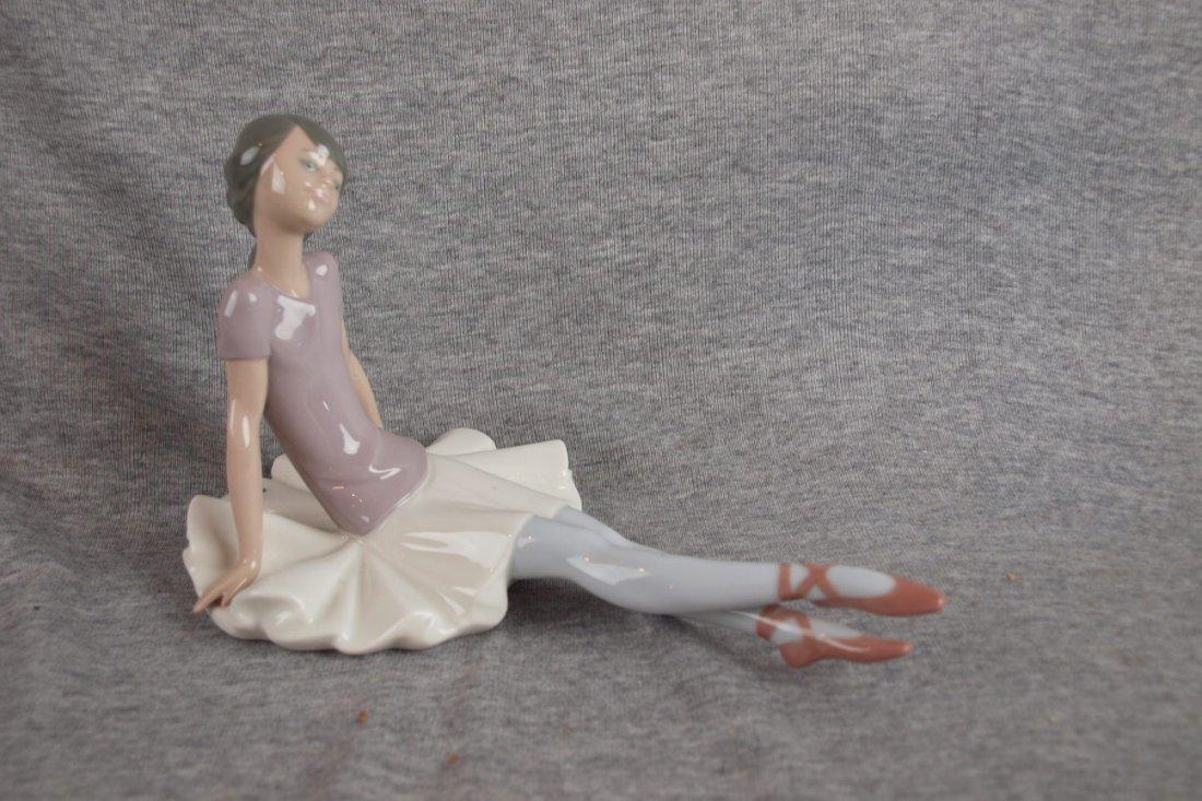 502B: Lladro figure of seated ballerina