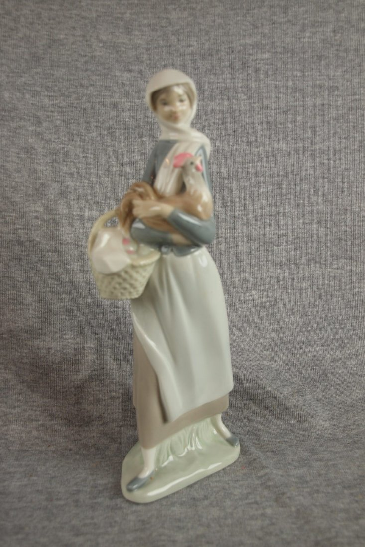 502C: Lladro figure of lady with chicken and basket of