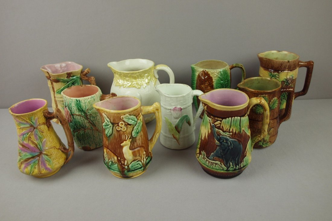 7:  Majolica lot of 10 pitchers, various condition, 6""