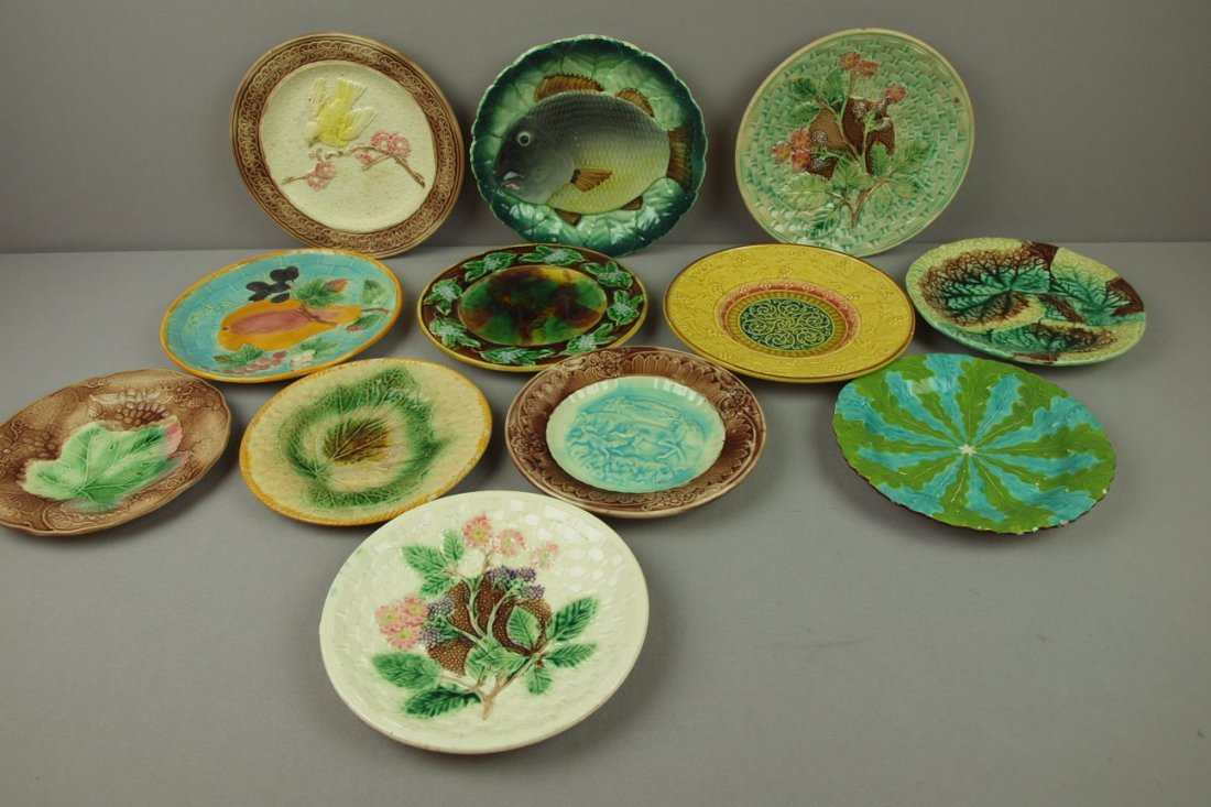 "11:  Majolica lot of 12 plates, 8"" to 9"", various condi"