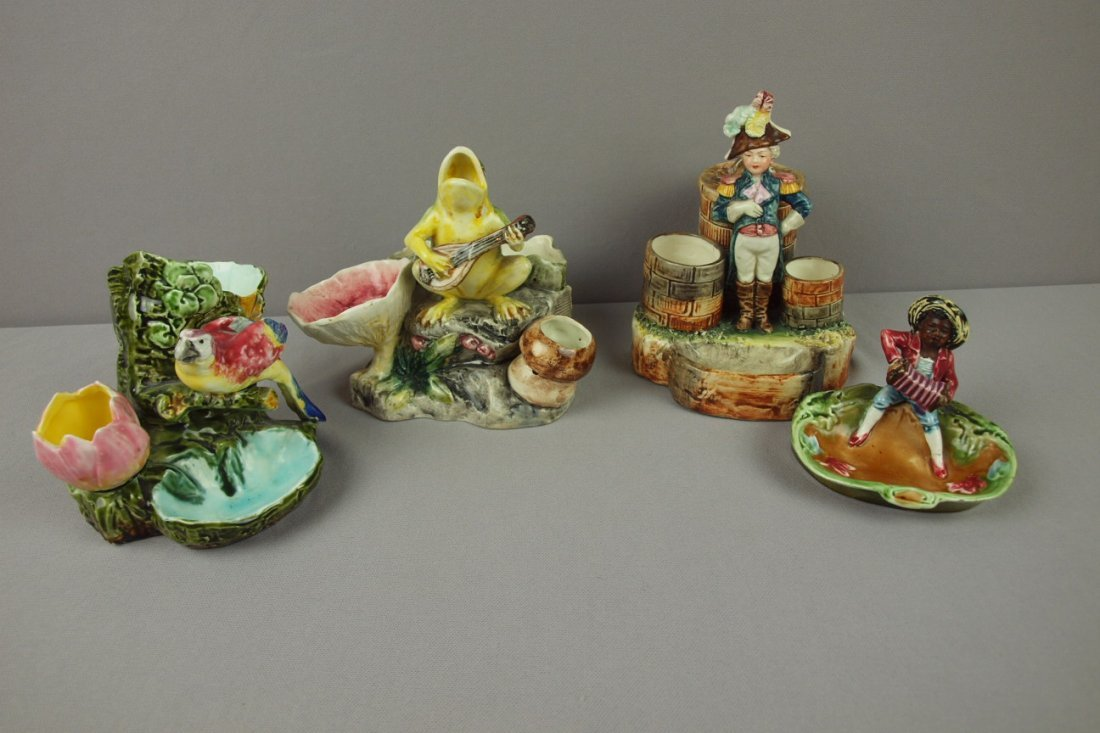 21:  Majolica lot of 4 figural match strikers, various