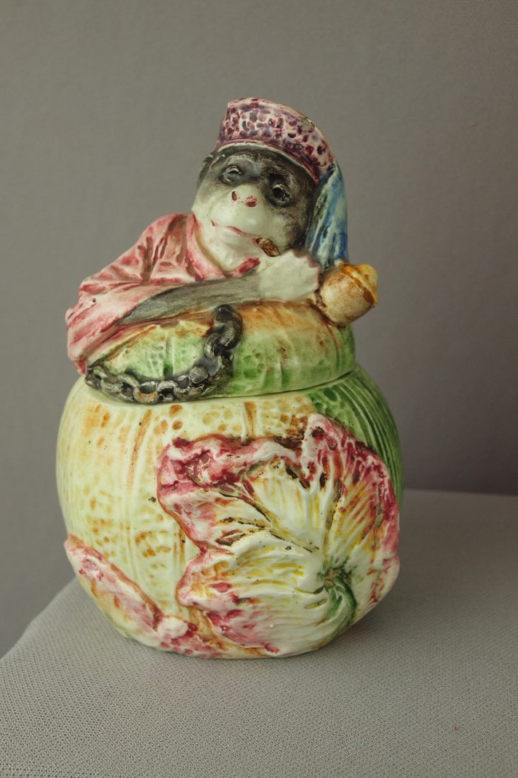 401:  Continental figural tobacco jar with monkey atop